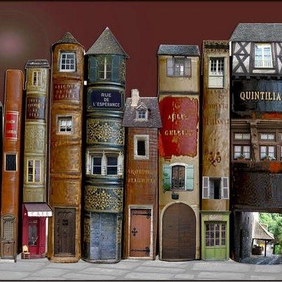 Altered books ~ A town made of book spines                                                                                                                                                                                 More