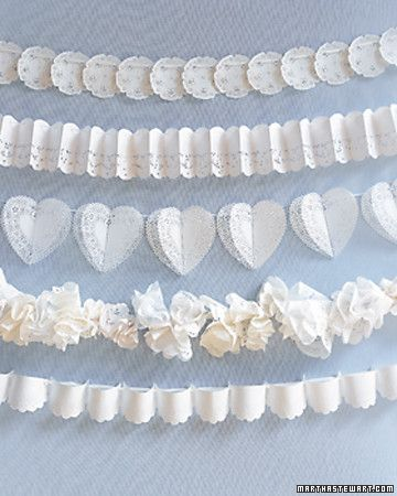 Doilies and silk ribbons combine to make graceful garlands to be draped over pews at the wedding ceremony or festooned along reception tables. From top: Lacy circles are laid flat and threaded directly onto ribbon, then slid close to overlap. Accordion folds add a cheerful cadence to paper trim. Folded pairs of heart-shaped doilies create a three-dimensional effect. Round doilies are gathered into frilly puffs, then wired to a ribbon. A scalloped edge comes from folding circular doilies in…