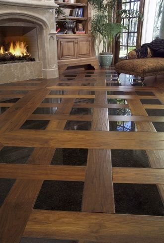 Footworn Walnut with tile inlay from Carlisle flooring. This is an example of Versailles parquet flooring.