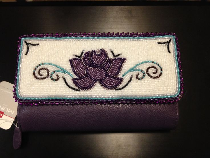 Purple leather wallet with beadwork by Olivia Agnes of Nulato, AK.