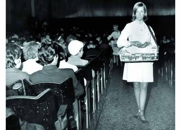 Remember when the ice cream lady walked down the cinema aisle in the interval to sell ice cream tubs and refreshments from her little tray. Nostalgic!