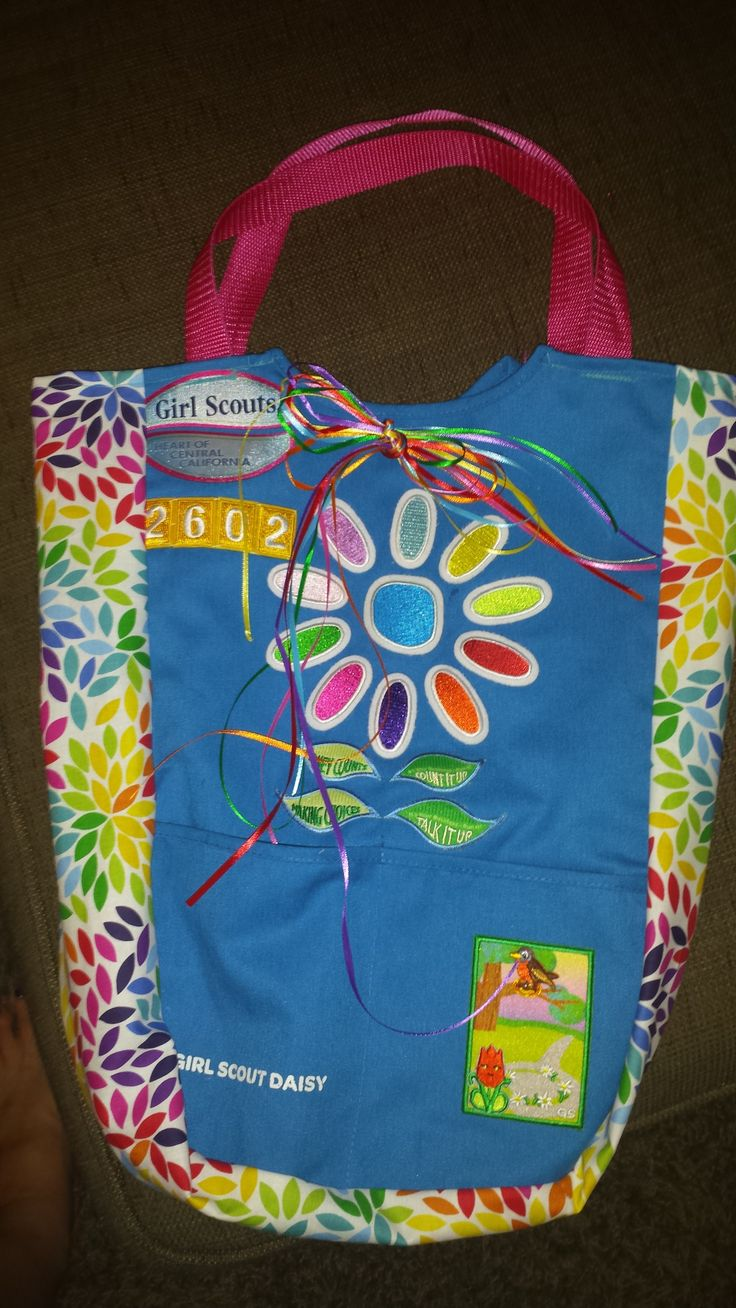 We made bags out of last year's Daisy Tunics, they turned out absolutely adorable! Cut the tunics apart, sew a straight strip of fabric onto both sides and add a handle. It took a bit of skill, but we did it as a troop and even earned a sewing badge for our Brownie vests in the process!