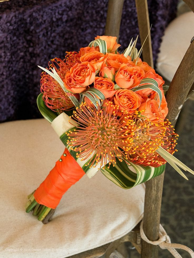 I don't like the vibrant color of the overall bouquet, but I adore the funny textured looking flowers in the bottom middle.