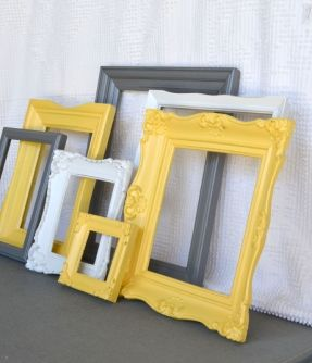 Find old frames at good will spray paint them yellow and purple. Then put chicken wire behind them and hang photos.