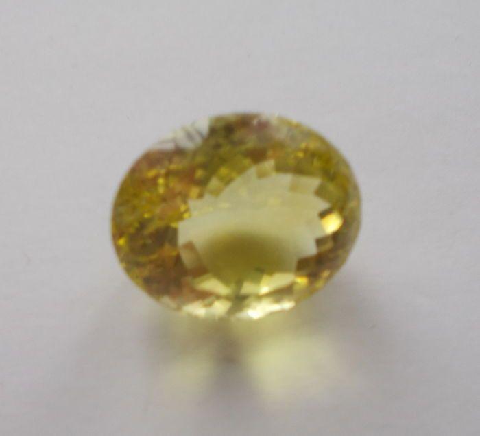 Catawiki Online-Auktionshaus: 1 Citrin, orangish-yellow, 8,80 ct., 1 grün-gelber Lemon-Citrin, 25,48 ct.