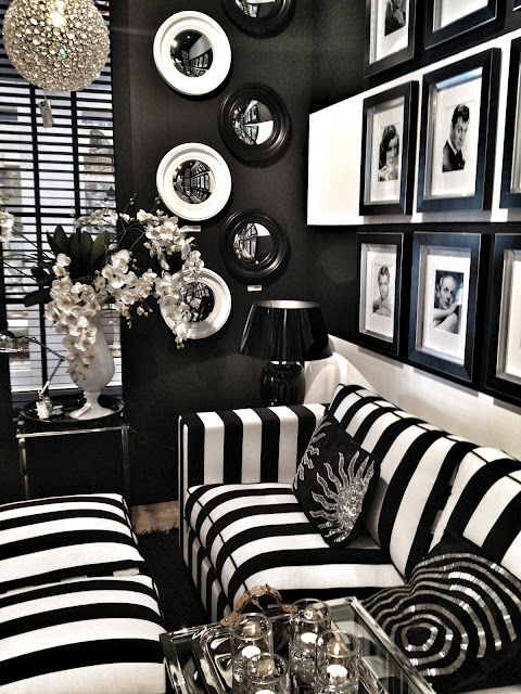 Living Room ~ Black + white interior makes a bold statement on a personal & artistic expression.