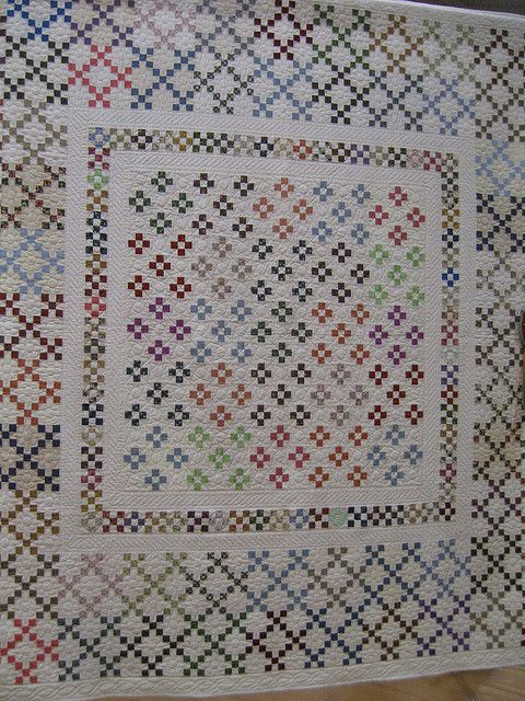 """That is a lot of very small double 9-patches.  Squares in the 9-patch appear to finish 1""""  - even with a lot of chain piecing that is a boatload of work."""