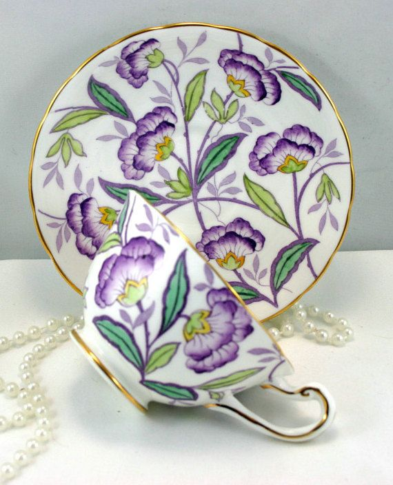 Lovely, Royal Chelsea Teacup & Saucer, Sweet Floral Pattern, Gold Rims, Bone China made in England in 1960s. In good condition, no chips, cracks, crazing or repairs. The Saucer measures-5.5(14cm) in diameter. The Cup opening-4(10cm), with the Handle-5(12.5cm) the Height-2.2(5.5cm)