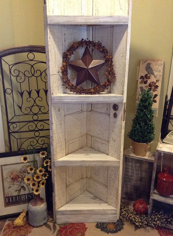 This item is constructed of reclaimed barn wood for the shelving, and a reclaimed door for the body. The original white distressed finish
