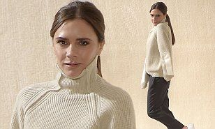 Victoria Beckham ditched her trademark heels for casual trainers as she took to the runway at the end of her incredible catwalk show on Sunday.