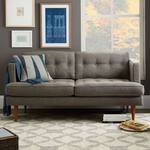 The Peggy Loveseat combines clean, classic lines with retro details, like tufted back and seat cushions and tapering pecan-stained solid wood legs.