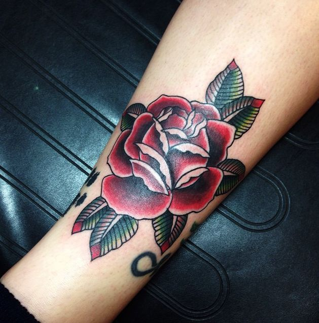 traditional deep red rose tattoo by andy revenant