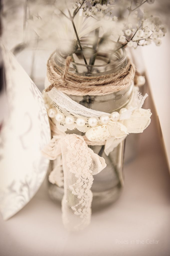 Jam-jar table decorations, vintage lace and pearls, at Hargate Hall, Buxton, Derbyshire. UK wedding photography by www.pixiesinthecellar.co.uk