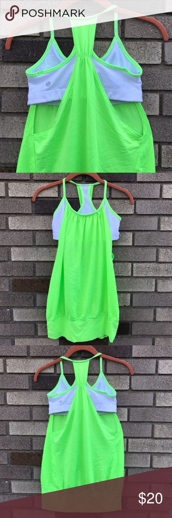 Lululemon Neon Bra Tank Seriously awesome tank. So bright!  Neon green loose tank over a white bra with neon green accents. Some small marks that are barely noticeable, but price reflects this. lululemon athletica Tops Tank Tops