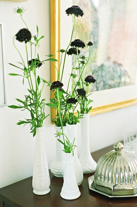 flowers grouped in milk glass individual vases-Little Green Notebook