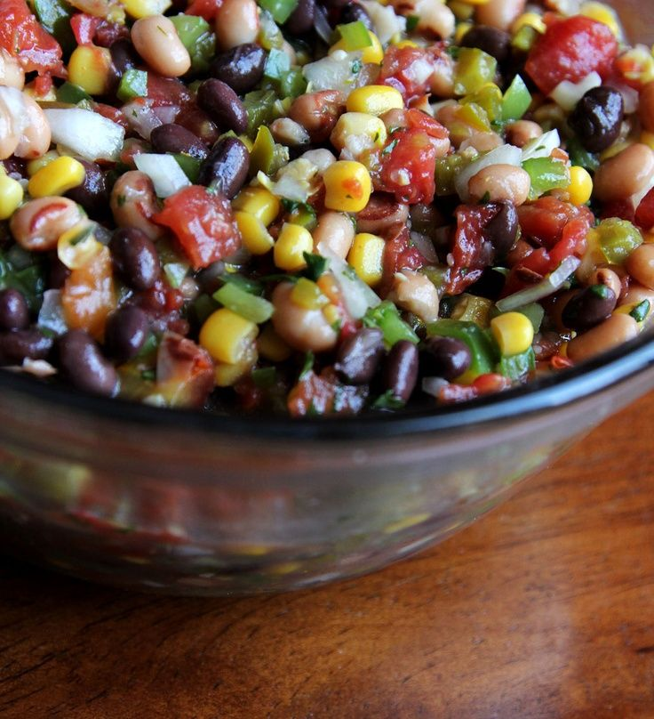 Cowboy Caviar  Ingredients:    1 can (15 oz) black beans  I can (15 oz) black-eyed peas  1 can (15 oz) diced tomatoes  1 can of corn (can also use frozen)  1 small onion (can substitute green onions)  ½ green pepper  ½ cup chopped jalapenos  ¾ cup chopped cilantro  garlic salt  Zesty Italian dressing  1 lime