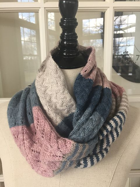 This cowl is knit with various stitch styles in color blocks, and designed to wear long or wrap once. Fingering yarn in a soft merino and cashmere blend give it beautiful drape and soft comfort, and makes it light enough to transition into spring.