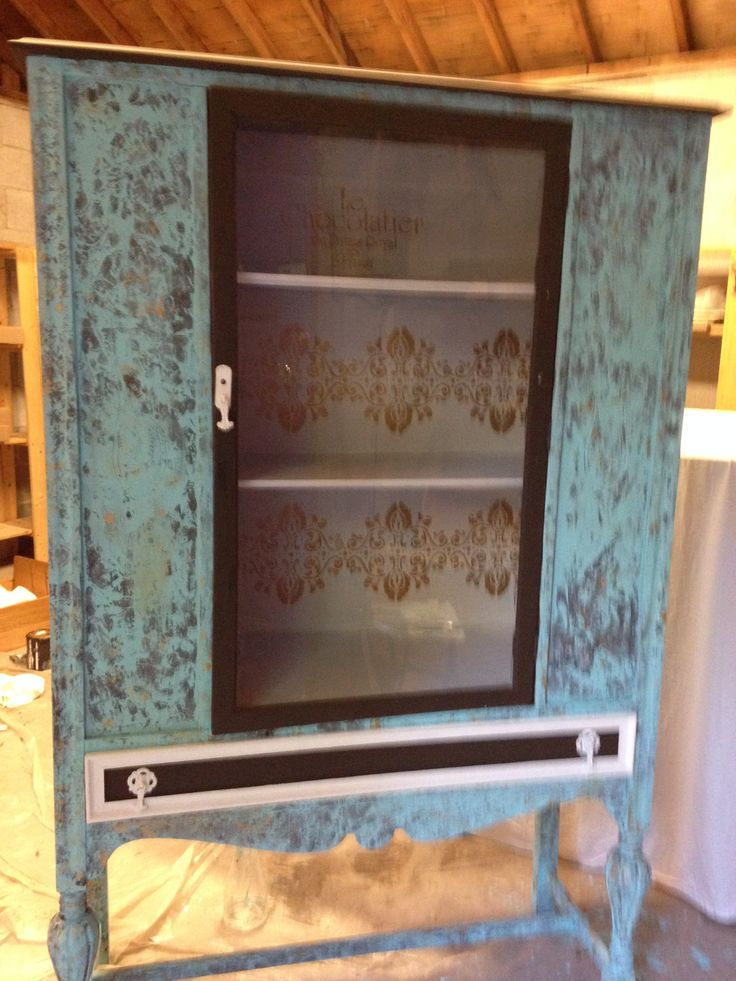Antique china cabinet, circa 1930s, transformed with van Gogh Fossil paints and frottage technique.  SOLD