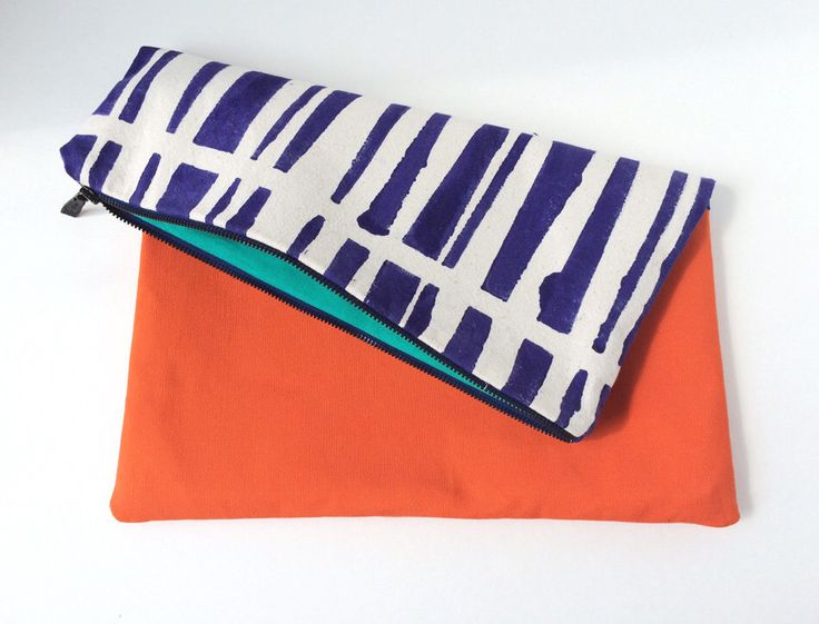 A personal favorite from my Etsy shop https://www.etsy.com/listing/228158553/handmade-clutch-bag-large-geometric
