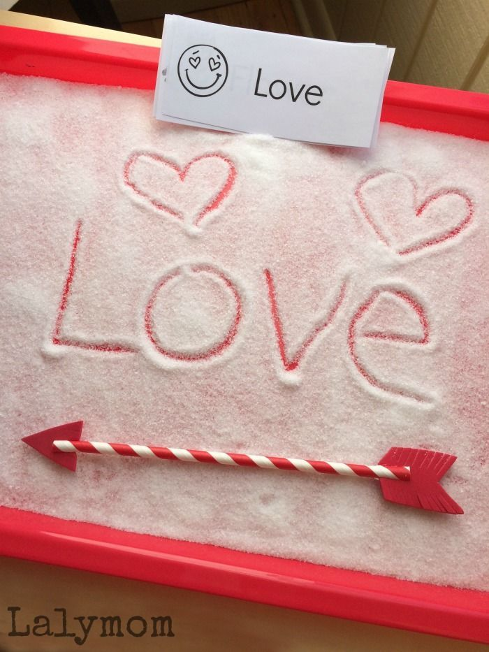 Super simple, fun writing activities for preschoolers and kindergartners. An easy Valentine's Day salt writing tray. Free word card printable.