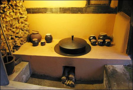 "The traditional Korean fireplace in the kitchen is the starting point for heating the home in the Korean hanok, or traditional house. This under-floor heating device, called ""ondol,"" is used to get through long, cold Korean winters. The history of ondol goes back to the Neolithic Age and a campaign is under way to promote it globally."