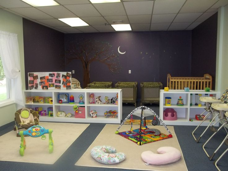 The separation in this room between a napping/resting area and the play areas is great.