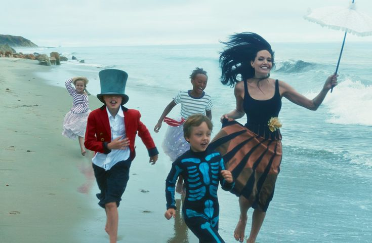 (by Annie Leibovitz. VOGUE) Free Spirits - Angelina plays ringmaster on the beach with four of her six children (from left): Vivienne, Shiloh, Zahara, and Knox. Jolie Pitt wears a Wolford bodysuit and a Bottega Veneta skirt.  Fashion Editor: Tonne Goodman