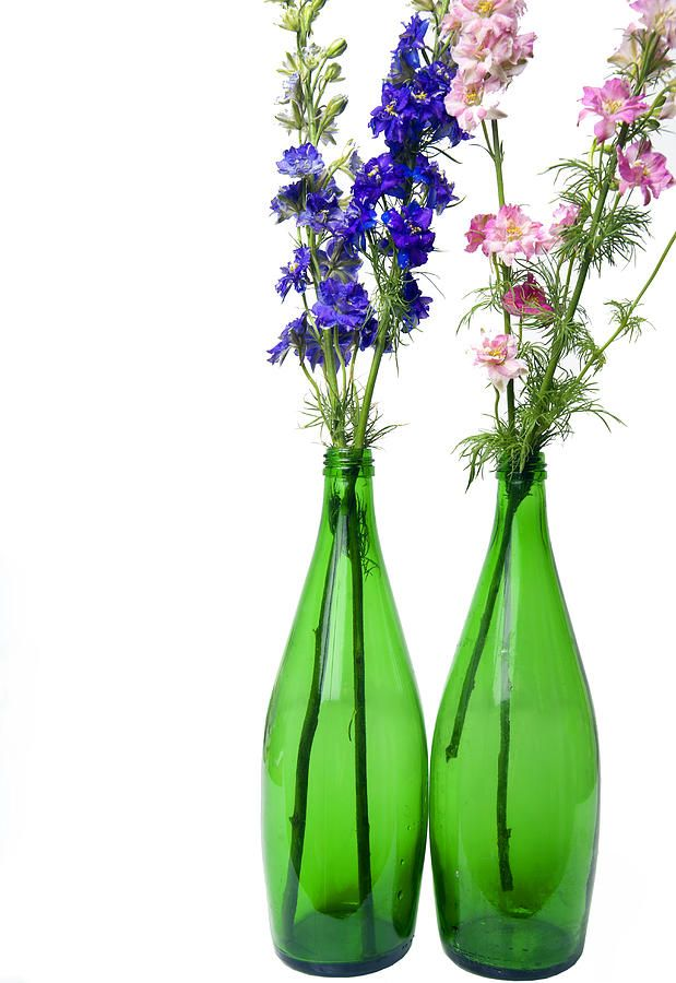138 best anael 39 s flowers images on pinterest wedding for Flowers in glass bottles