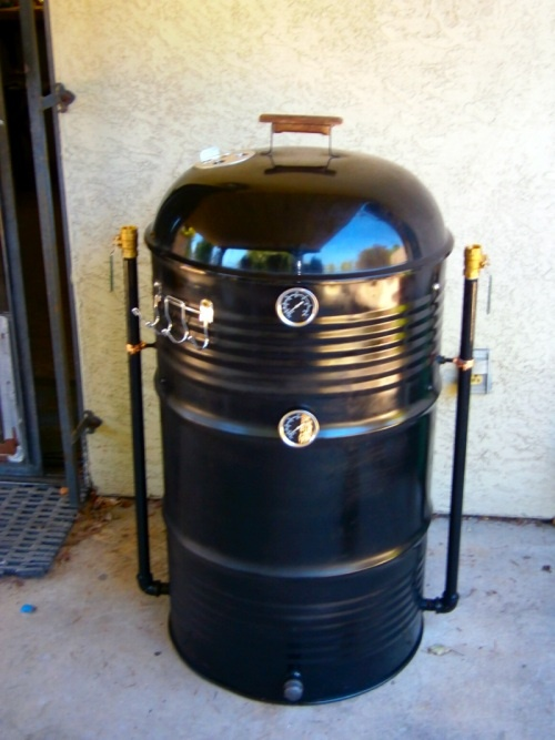 My first DIY UDS -Ugly Drum Smoker! I made her from a 55 gallon food grade drum and a donated 22.5 Weber Kettle Lid and grates.