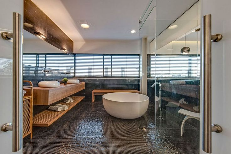 Bathroom Design Ideas - Open Shelf Below The Countertop // A shelf underneath your bathroom counter eliminates the need to store your towels in a linen closet away from the bathroom and makes sure you never have to call for someone to bring you a towel.