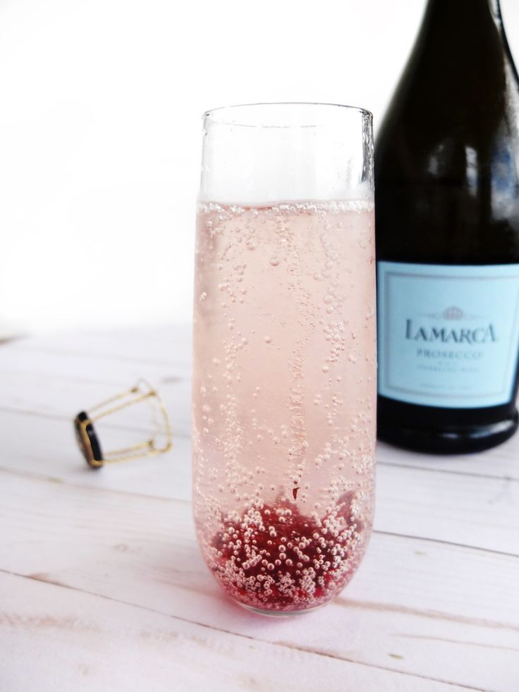 An easy New Years Eve champagne cocktail for ringing in the new year. Uses hibiscus flowers in syrup.