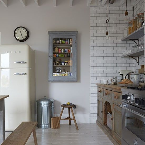 Step inside this industrial-style flat in a Victorian terrace in London. Bespoke cabinets, like the one on the wall next to the fridge-freezer, are made from reclaimed floorboards.
