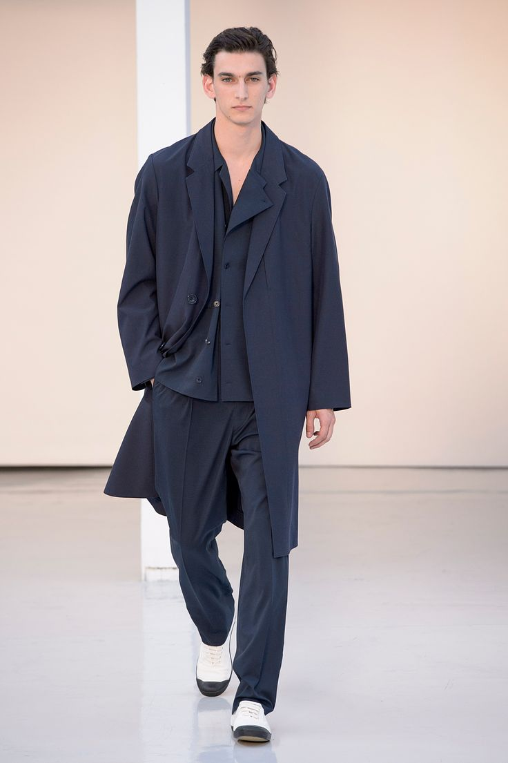 18. Suit coat in water-repellent wool-cotton, field shirt and one-pleated pants in cool wool gabardine, sneakers in cotton denim #lemaire