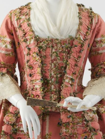Detail of 1775 compere stomacher heavily trimmed with fly fringe.