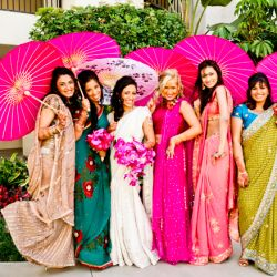 Mismatched saris + hot pink parasols for the bridesmaids at this colourful Indian wedding in California. (via Beautiful Day Photography)