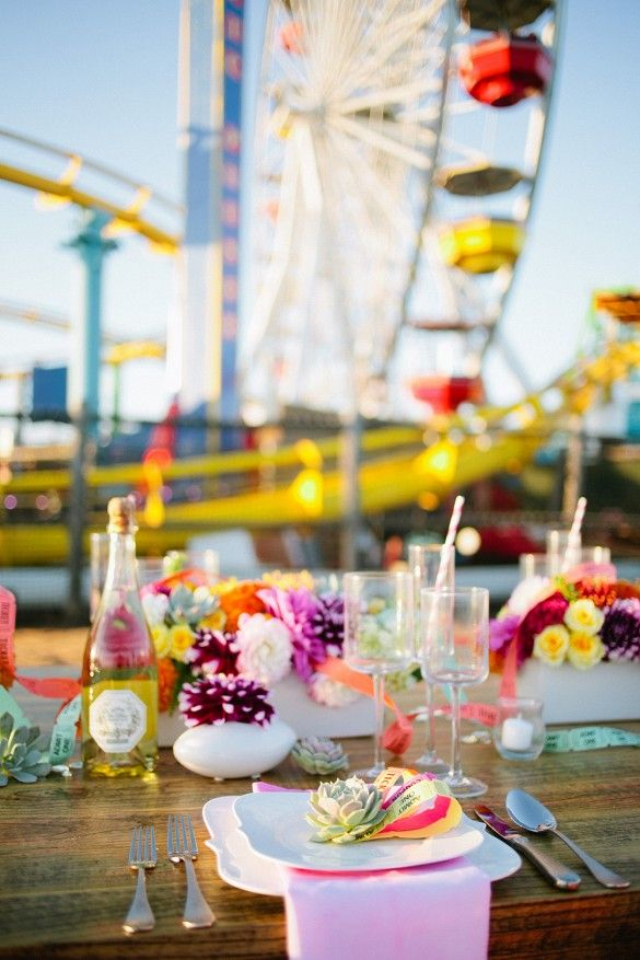 Santa Monica Pier pop-up wedding with flowers, succulents, and carnival ticket details.