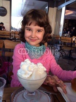 Cute baby girl front of a tasty granita, sicilian slush with cream