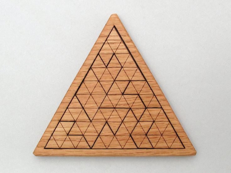 Wooden Triangles Geometric Puzzle - Red Oak Laser Cut Wood Jig Saw Puzzle. $22.95, via Etsy.