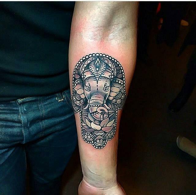 Hamsa with a Ganesh by Grant at Red Baron Ink, NYC.