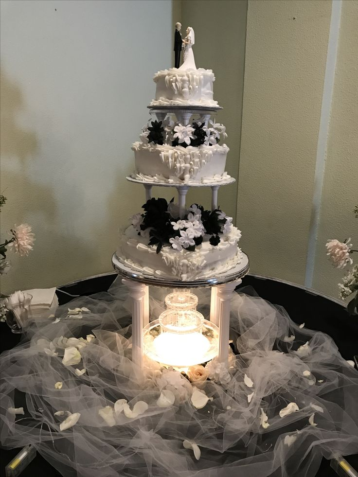 Three-tier heart shaped wedding cake with white strawberry and chocolate cake