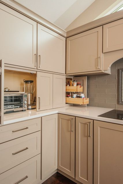Inspiration for a transitional kitchen in Seattle with glass-front cabinets, beige cabinets, beige backsplash and subway tile backsplash.