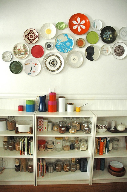 Would be nice for the dining area. Find mismatched, neat plates. Can get hangers at Hobby Lobby.