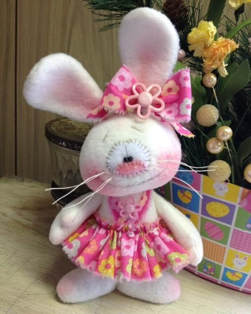 She is made from a soft cream colored fleece. The skirt has a bright pink background with fun spring colored flowers printed on it! VERY CUTE! Her eyes are tiny black beads, pink wool felt nose and hand stitched smile. | eBay!