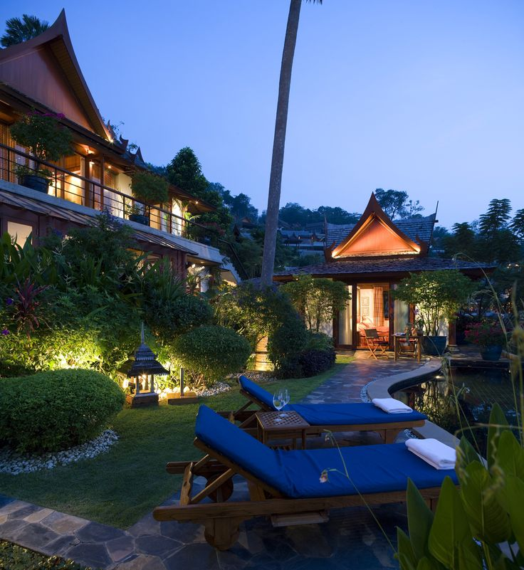 This luxurious Asian inspired outdoor retreat has beautiful landscaping that surrounds lounge chairs and an in ground pool. Click the image to see how much it costs to hire a professional landscaper.