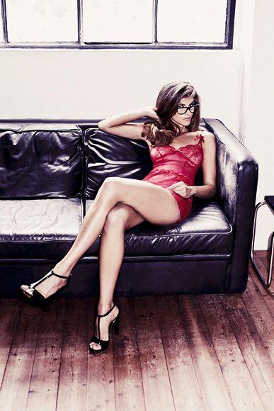 black glasses, black heels, black leather couch (visual ...