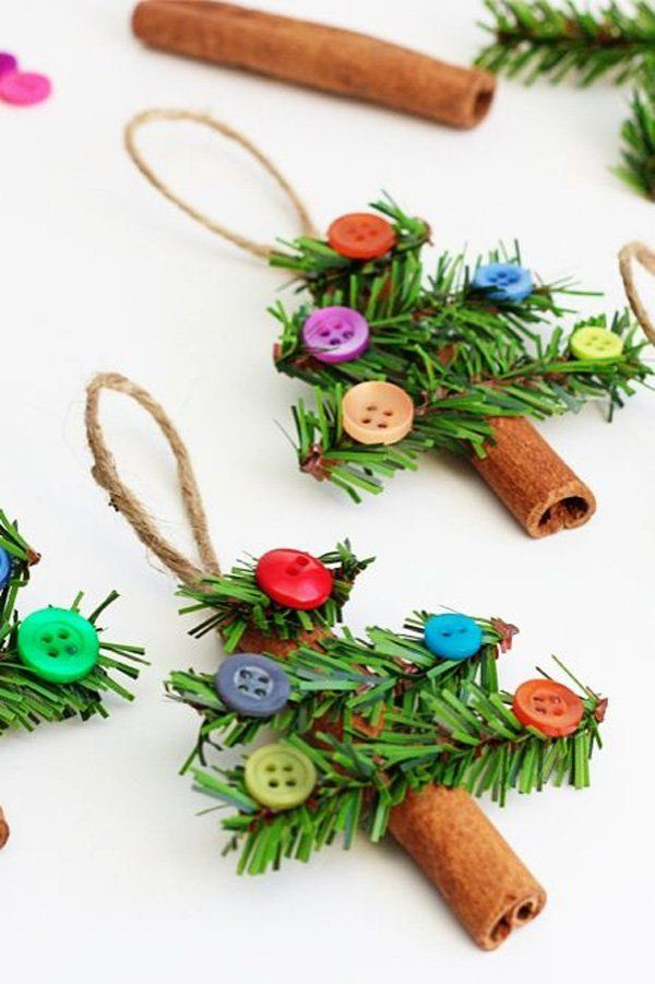 Mini Christmas tree hangings made out of used or recycled materials. Combine together old Christmas tree plastic leaves, colorful buttons, cardboard or wood and rope to make a bunch of these cute Christmas tree decors.