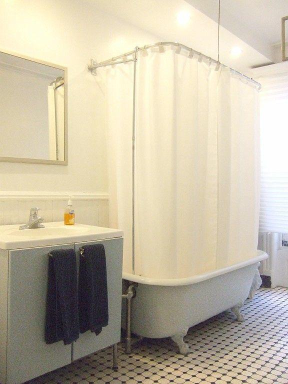 Brooklyn apartment rental: clawfoot tub/shower; (1) window overlooking garden