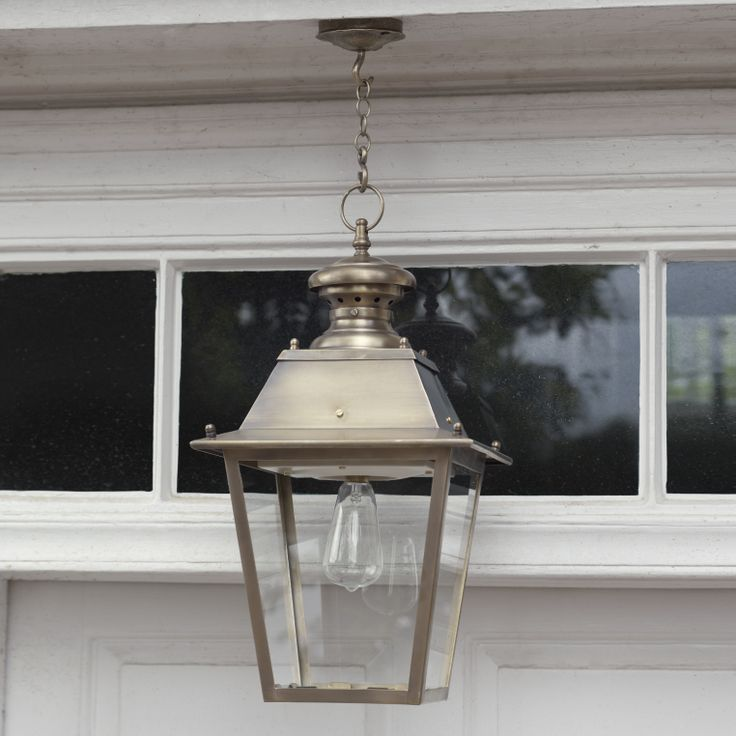 This Canterbury #Lantern in #Antiqued #Brass adds grandeur to any #frontdoor
