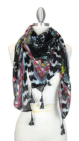 A funky scarf with tassles! Available today at shopbluedoor.com!