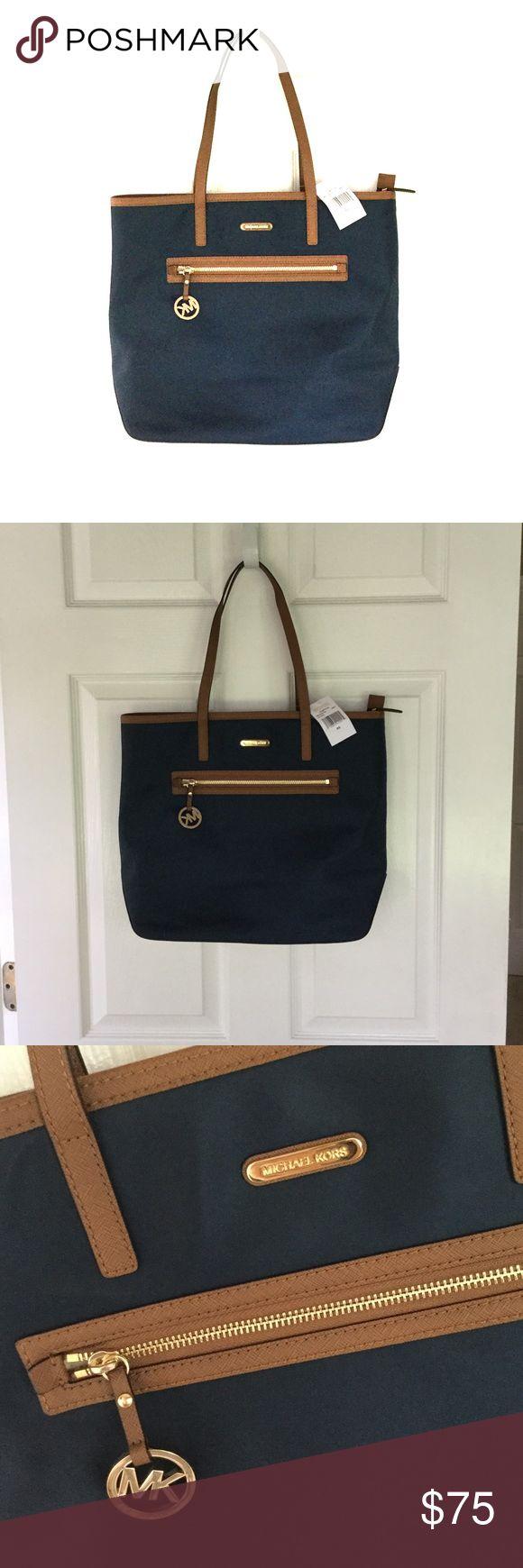 Michael Kors navy shoulder bag Michael Kors navy shoulder bag. NWT. Lots of room. Double handle. Never worn/used. Michael Kors Bags Shoulder Bags